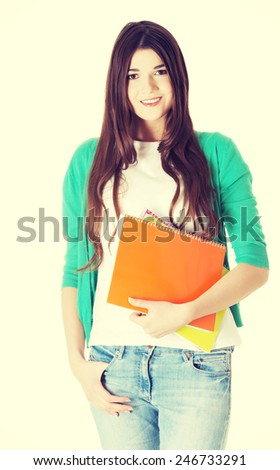 Young beautiful student woman with files, workbook. - stock photo