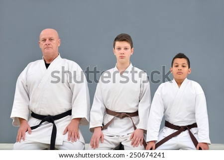 young, beautiful, successful multi ethical karate kids posing with karate master - stock photo