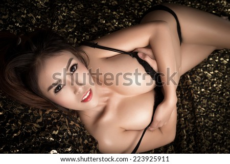 Young beautiful tanned Sexy Asian woman wearing elegant lingerie  - stock photo