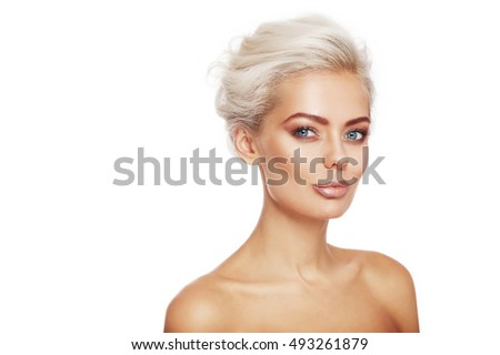 Young beautiful tanned sexy woman with stylish make-up and hairdo over white background, copy space