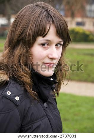 Young beautiful teenage girl looking at camera - stock photo