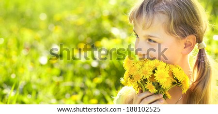 young beautiful teenager girl with dandelion bouquet. banner - stock photo