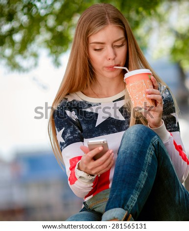Young beautiful teenager girl with mobile phone outdoor - stock photo