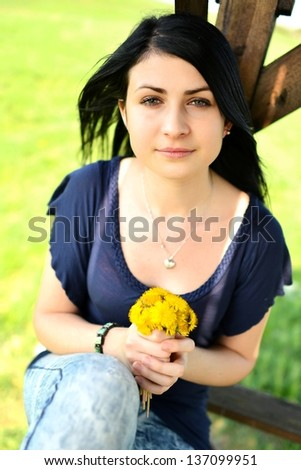 young beautiful teenager with dandelion bouquet - stock photo