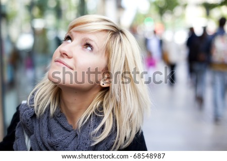 Young beautiful urban girl looking at what surrounds her. - stock photo