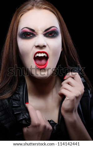 Young beautiful vampire woman isolated - stock photo