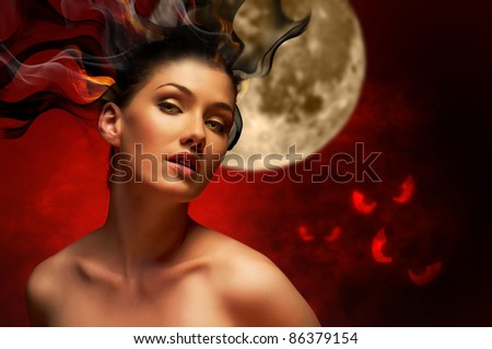 Young beautiful witch. Halloween day - stock photo