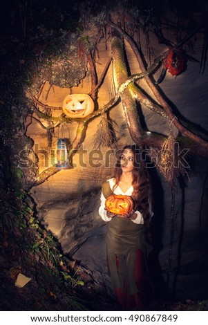 Young beautiful witch in her cave. Fairy tale about Halloween.