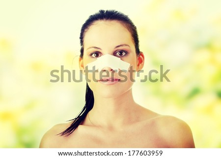 Young beautiful woman after nose surgery - stock photo