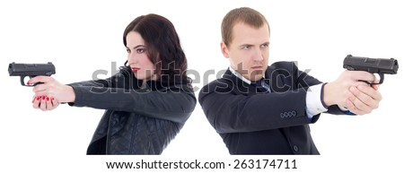 young beautiful woman and man shooting with guns isolated on white background - stock photo