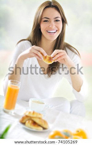 young  beautiful woman at breackfast - stock photo