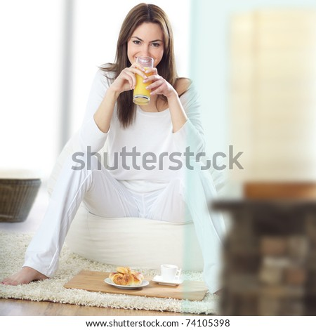 young beautiful woman at breakfast - stock photo