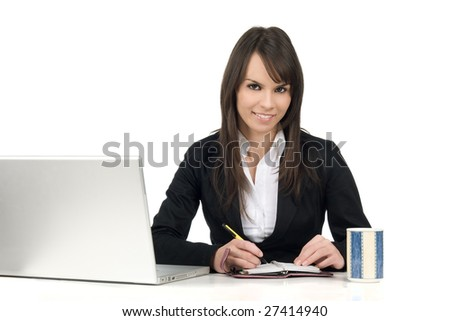Young beautiful woman at desk writing a note
