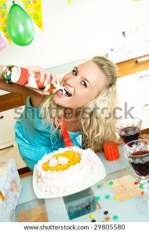 young beautiful woman at home celebrating her birthday