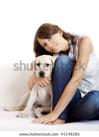 Young beautiful woman at home with her cute dog - stock photo