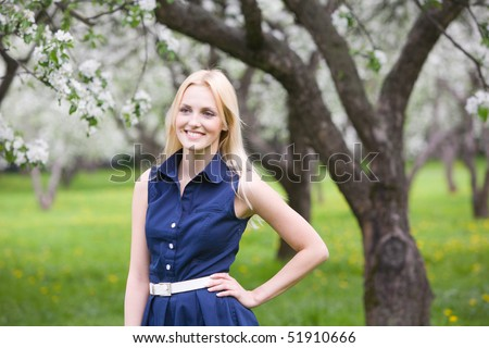 Young beautiful woman at spring park