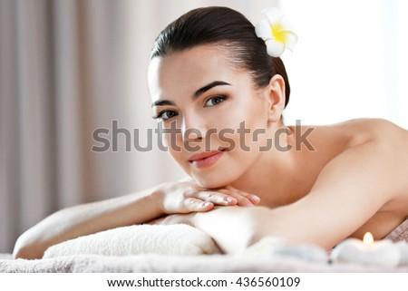 Young beautiful woman at the spa salon - stock photo