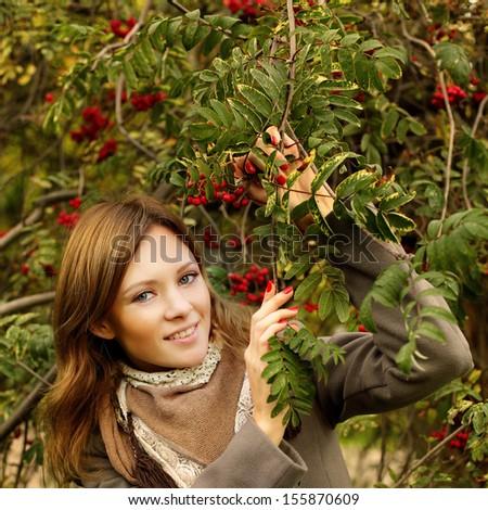 Young beautiful woman, autumn fashion background - stock photo