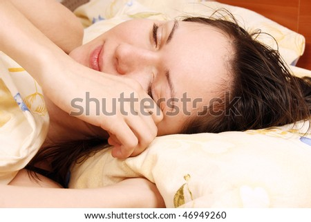 Young beautiful woman awaking - stock photo