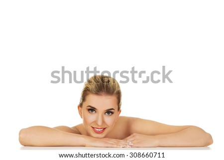 Young beautiful woman based on table, isolated on white. - stock photo