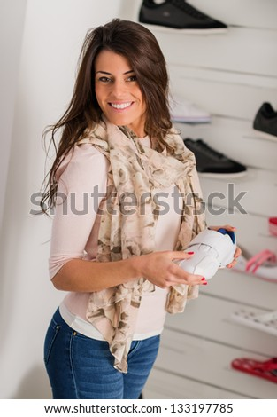 Young Beautiful Woman Buying Shoes, Indoors