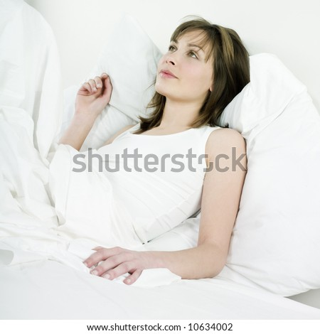 young beautiful woman caucasian in her bedroom
