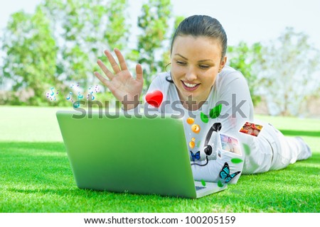 Young beautiful woman chatting by her laptop and mobile wireless internet connection. - stock photo