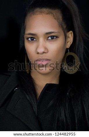 young beautiful woman close up portrait, on black background - stock photo