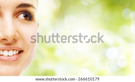 Young beautiful woman close-up portrait with perfect glowing face skin - stock photo