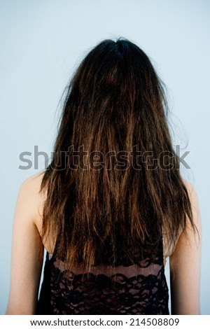 Young beautiful woman combing her luxuriant hair ,fashion portrait of a woman with long and curly hair - stock photo