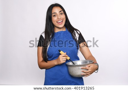 Young beautiful woman cooking. Isolated white background. - stock photo