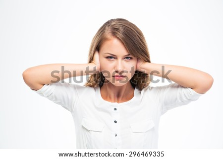 Young beautiful woman covering her ears isolated on a white background. Looking at camera - stock photo