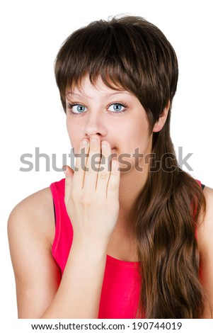 young beautiful woman covering her mouth with her hand. isolated on white background - stock photo