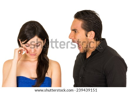 young beautiful woman crying while husband boyfriend screams at her isolated on white - stock photo