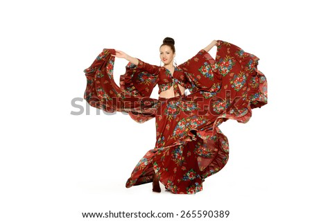 Young beautiful woman dance in gypsy