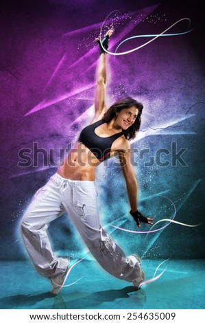 Young beautiful  woman dancing modern dance hip-hop on colorful  background. With lights effect. - stock photo