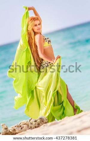 young beautiful woman dancing on sand beach in tropics, vacation vitality healthy living concept - stock photo