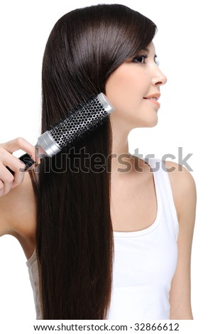 young beautiful woman do her long straight healthy hair