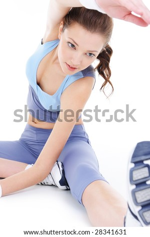 young beautiful woman doing physical stretch - isolated