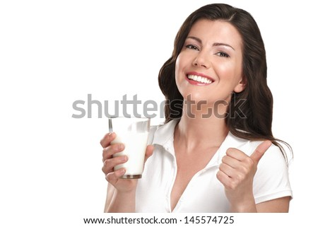 young beautiful woman drink a glass of milk on white - stock photo