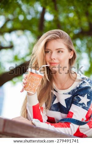 Young beautiful woman drinking coffee - stock photo
