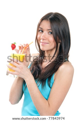 Young beautiful woman drinking fresh orange juice cocktail with strawberry isolated on a white background - stock photo