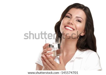 young beautiful woman drinking fresh water on white - stock photo