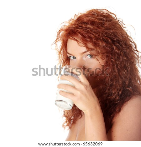 Young beautiful woman drinking milk, isolated on white - stock photo
