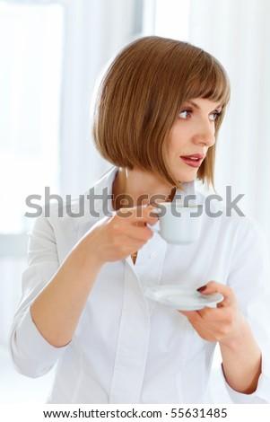 Young beautiful woman drinking morning coffee - stock photo