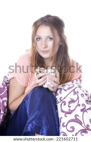 Young beautiful woman drinking something in bed.