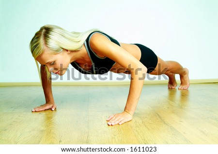 Young beautiful woman during fitness time and exercising - stock photo
