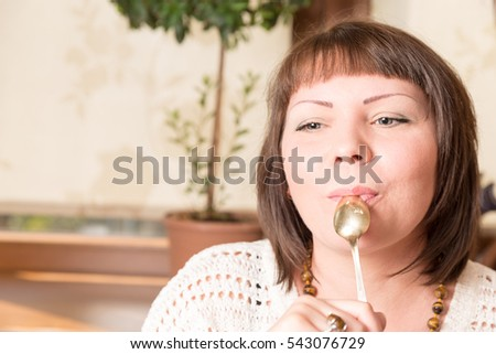 Young beautiful woman eating a dessert. Sweet life with cake
