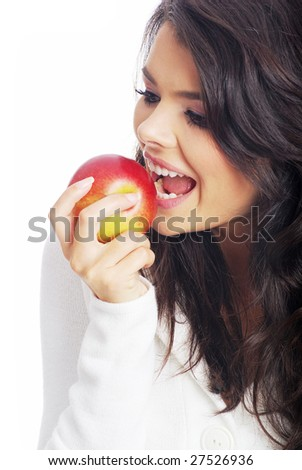 Young beautiful woman eating green apple isolated over white background - stock photo