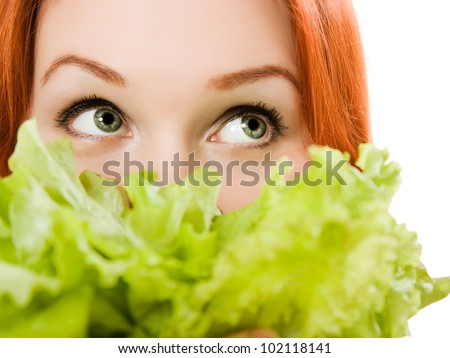 young beautiful  woman eating salad close up